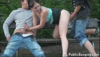 Gangbang with a cute teen in the middle of a city center