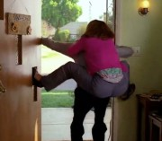 Patricia Heaton riding Axel's back out the door