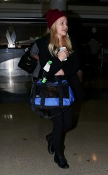 Olivia Holt - at LAX Airport 12/18/13