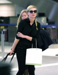 Kirsten Dunst - at LAX Airport 1/16/14
